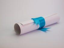 Diploma tied with a blue ribbon Royalty Free Stock Photos
