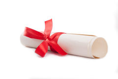 Diploma tied with red ribbon on a white  Royalty Free Stock Images