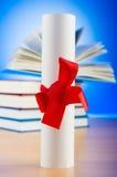 Diploma y pila de libros Foto de archivo libre de regalías