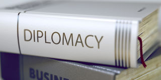 Diplomacy Concept on Book Title. 3D Illustration. Royalty Free Stock Image