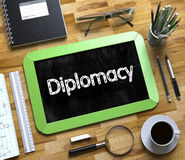 Diplomacy Handwritten on Small Chalkboard. 3D. Royalty Free Stock Photos