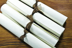 Diplomas or Certificates. Diplormas or Certificates rolled and tied with ribbon on a wooden surface stock image