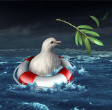 Diplomatic crisis. And war distress concept with a drowning white dove in an ocean during a storm losing his olive branch as a metaphor for lost opportunity for Royalty Free Stock Photography