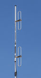 Dipole antenna for telecommunications with blue sky background. Royalty Free Stock Photos