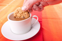Dipping biscuit Stock Image