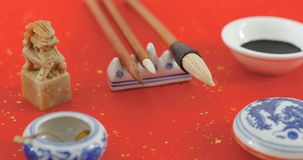 Dipping black ink for writing Chinese calligraphy for lunar new. Year Stock Images