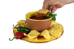 Dipping a Chip in Salsa Royalty Free Stock Photos