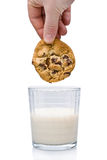 Dipping A Chocolate Chip Cookie Into A Glass Of Milk Stock Images