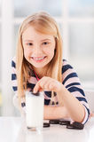 Dipping a cookie. Stock Photography