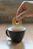 Dipping a Cookie Stock Images