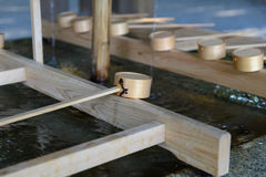 Dipping cups at Meiji jingu in Tokyo Stock Images