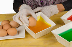 Dipping eggs stock photography