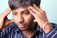 Dipressed Indian Men. Worried Indian man in lonely Royalty Free Stock Photos