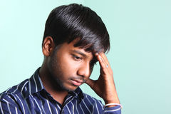 Dipressed Indian Men. Worried Indian man in lonely Royalty Free Stock Photo