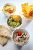 Dips bowls. Couscous guacamole hummus tomato stock photo