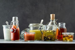 Dips and marinades in various flavors and jars. Dips and marinades in all kinds of flavors and various sized jars for concept about gourmet barbecue cooking stock images