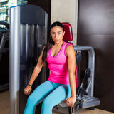 Dips press machine for triceps woman workout Royalty Free Stock Images