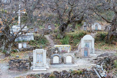 DIQING, CHINA - MAR 17 2015: The Catholic Cemetery at Cizhong. a Royalty Free Stock Photo