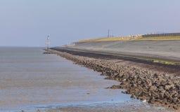 Dique holandês do mar imagens de stock royalty free