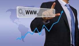 Dirección del web del hombre de negocios que entra Imagen de archivo libre de regalías