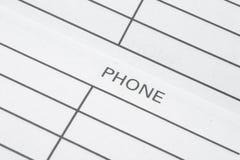 Direccionamiento y listín de teléfonos imagen de archivo