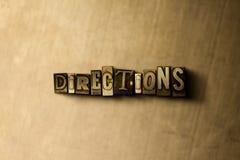 DIRECCIONES - primer de la palabra compuesta tipo vintage sucio en el contexto del metal Imagen de archivo libre de regalías