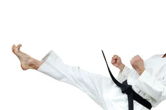 Direct blow leg is doing sportsman with black belt. Direct blow leg is doing sportsman royalty free stock photos