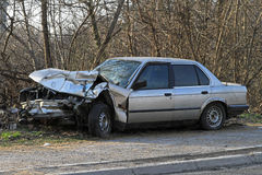 Direct collision. Crushed car in front collision traffic accident stock images