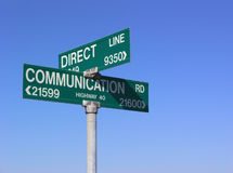 Direct communication. Sign, against blue sky stock image