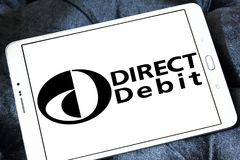 Direct debit payment system logo. Logo of Direct debit payment system on samsung tablet royalty free stock photography