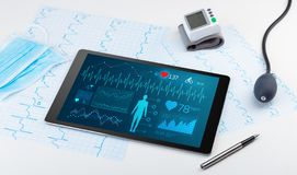 Direct diagnosis with medical application. Live medical screening with medical application on tabletn royalty free stock photography
