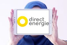 Direct Energie company logo. Logo of Direct Energie company on samsung tablet holded by arab muslim woman. Direct Energie is a French international electric royalty free stock image