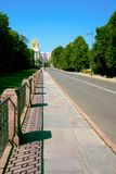 The direct fenced sidewalk and the road towards Catherine Palace in the summer solar morning. Direct fenced sidewalk and the road towards the Catherine Palace on royalty free stock photo
