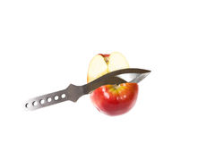 Direct hit. Red apple and missile knife isolated on the white background Royalty Free Stock Images