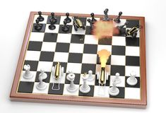 Direct hit! Little war on a chessboard. Stock Photos