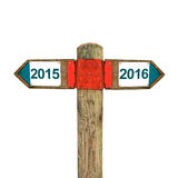 Direct message. 2015 year versus 2016 year direct message - Wooden signpost with two opposite sign arrows stock images