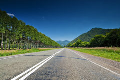 The direct road leading into the mountains. Royalty Free Stock Images