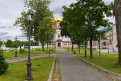 Direct road to the temple. The Valdai Iver Svyatoozersky Virgin Monastery. Iversky Cathedral 1655-56 royalty free stock photos