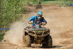 Direct section of the route. MOSCOW, RUSSIA - MAY 13, 2018: Beznosenko Boris 07, class ATV, in the first stage of the racing series RZR CAMP 2018, motorcycle royalty free stock photo