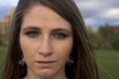 Direct Stare. A young brunette woman stares directly at you. Plenty of room for text royalty free stock photos