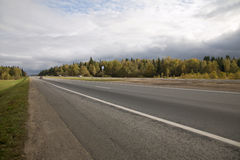 Direct suburban freeway with cars in early autumn Stock Image