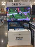 Direct TV. A Direct TV 4K display in a store set up for customer to look at royalty free stock images