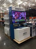 Direct TV Set Up. A Direct TV 4K display in a store set up for customer to look at Stock Photos
