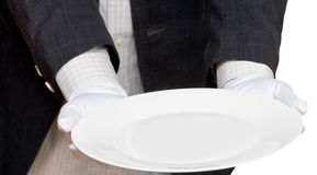 Direct view of empty white plate in hand in gloves Stock Images