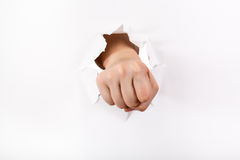 Direct view of the fist punches a paper Royalty Free Stock Photos