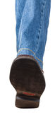Direct view of left leg in jeans and brown shoe Stock Photography
