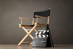 Directeur Chair, Filmklep en Megafoon het 3d teruggeven Royalty-vrije Stock Afbeeldingen
