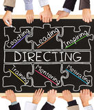 DIRECTING concept words. Photo of business hands holding blackboard and writing DIRECTING concept Royalty Free Stock Photography