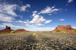 Direction Arizona. Hot Summer Arizona Highway with Monument Valley Rock Formations. United States Travel Theme Stock Photography