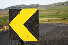 Direction arrow. Left arrow Street signs around the bend of a road Royalty Free Stock Photo